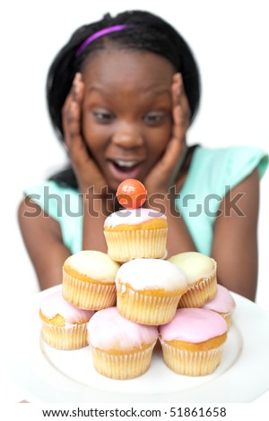 Astonished young woman looking at cakes against a white background