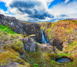 Astonishing view of  Kolugljufur canyon and Kolufossar falls. Kolugljufur gorge is located on river Vididalsa.  Location: Kolugljufur canyon, Vestur-Hunavatnssysla, Iceland, Europe