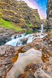 Astonishing view of  Kolugljufur canyon and Kolufossar falls. Kolugljufur gorge is located on river Vididalsa.  Location: Kolufossar waterfall, Vestur-Hunavatnssysla, Iceland, Europe
