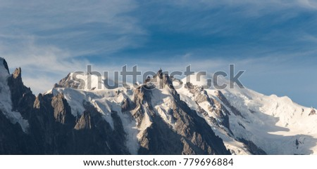 Astonishing view of the Mont Blanc mountain range during the summer. With it's beautiful glaciers, high peaks and easy treks, Mont Blanc is one of the most visited mountain in the world. #779696884