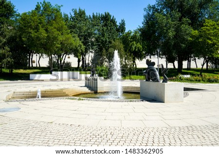 Astrakhan. Fountain in the center of Astrakhan on Lenin Avenue. Lenin Avenue with fountains and flower beds and the Astrakhan Kremlin.           #1483362905