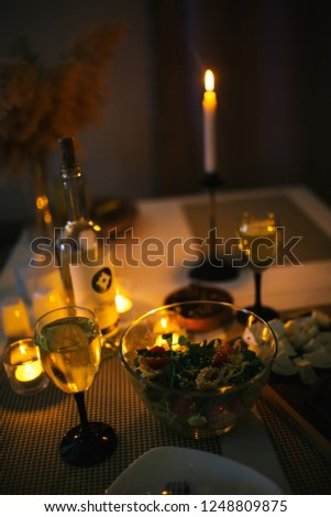 Astrakhan, Russia - December 1 2018: homemade dinner with cheese and wine. Romantic evening with candlelight, date #1248809875