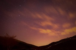 astral starry night sky with valley silhouette