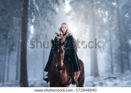 astride a horse.girl blonde...