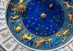 Astrological signs on ancient clock Torre dell'Orologio, Venice, Italy. Medieval Zodiac wheel and constellations. Golden symbols on star circle. Concept of astrology, horoscope and time.