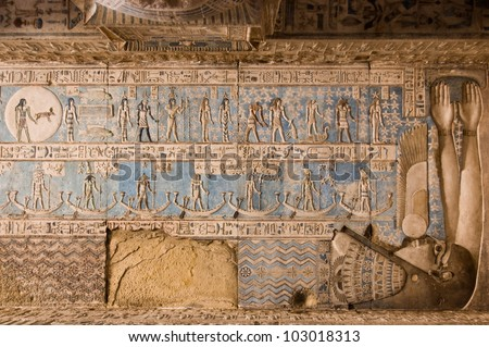 Astrological symbols on the ceiling of Dendera Temple near Qena, Egypt.  The goddess of the night Nut is enclosing the symbols with her body and arms.  Pisces, top left. Carving, over 1000 years old.
