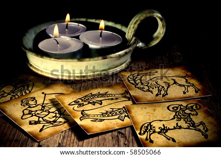 astrology and its zodiac symbols with three candles