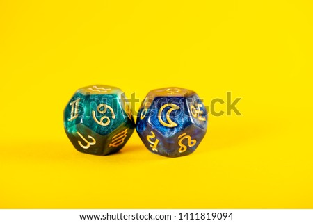 Astrology Dice with zodiac symbol of Cancer Jun 21 - Jul 22 and its ruling celestial body the Moon on Yellow Background #1411819094