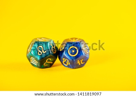 Astrology Dice with zodiac symbol of Leo Jul 23 - Aug 22 and its ruling celestial body the Sun on Yellow Background #1411819097