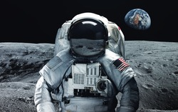 Astronaut at the moon. Abstract space wallpaper. Universe filled with stars, nebulas, galaxies and planets. Elements of this image furnished by NASA