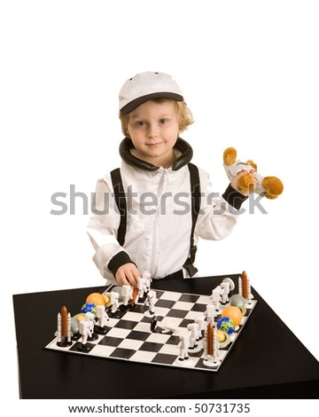 Astronaut boy playing chess