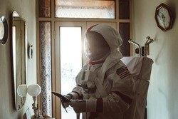 Astronaut coming back on earth after long time it s been abandoned. Concept about science and scifi