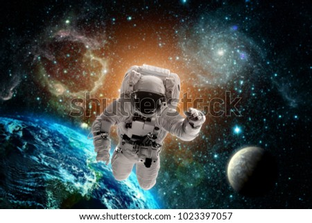 astronaut flies over the earth in space. Elements of this image furnished by NASA #1023397057