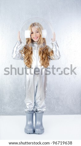 Astronaut futuristic kid girl with silver full length uniform and glass bubble helmet