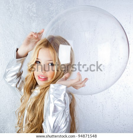 Astronaut futuristic kid girl with silver uniform and glass helmet