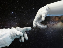 Astronaut hand and robotic hand on outer space background. Elements of this image furnished by NASA.