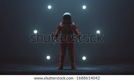 Astronaut in an Orange Space Suit with Black Visor Standing in a Alien Void 3d illustration 3d render   Stockfoto ©