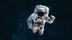 Astronaut in dark deep space. Science wallpaper. Elements of this image furnished by NASA