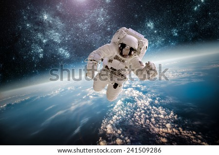 Astronaut in outer space against the backdrop of the planet earth. Elements of this image furnished by NASA. #241509286