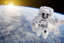 Astronaut in outer space, in background the earth -  Elements of this image furnished by NASA