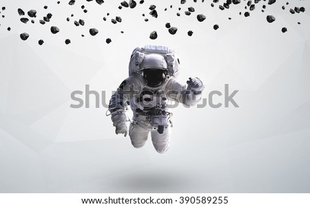 Astronaut in outer space modern art. Elements of this image furnished by NASA. #390589255