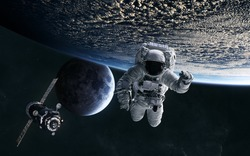 Astronaut, ISS in low Earth orbit. Moon. Solar system. Science fiction. Elements of this image furnished by NASA