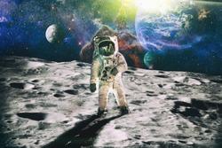 Astronaut looks up at an alien sun that illuminates the barren world he stands on.