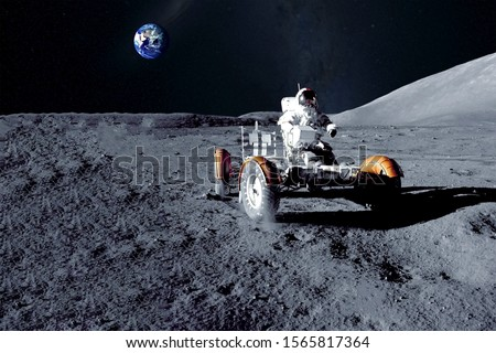 Astronaut near the moon rover on the moon. With land on the horizon. Elements of this image were furnished by NASA. Foto d'archivio ©