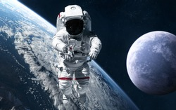 Astronaut on background of planets of deep space. Science fiction. Elements of this image furnished by NASA