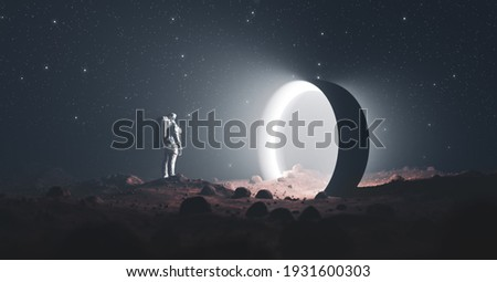 Astronaut on foreign planet in front of spacetime portal light. Science fiction universe exploration. 3D render Stock photo ©