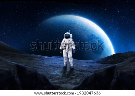 Astronaut on rock surface with space background ,astronaut walk on the moon wear cosmosuit. future concept