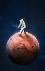 Astronaut on surface of red planet Mars. Martian colonizer. Spaceman. Expedition to Mars. Elements of this image furnished by NASA.