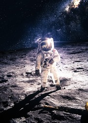 Astronaut on the moon. Elements of this image furnished by NASA