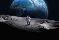 Astronaut on the surface of Moon. Planet Earth on the background. Apollo space program. Elements of this image furnished by NASA.