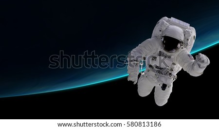 astronaut orbiting the blue planet, 3d illustration - elements of this image furnished by NASA #580813186