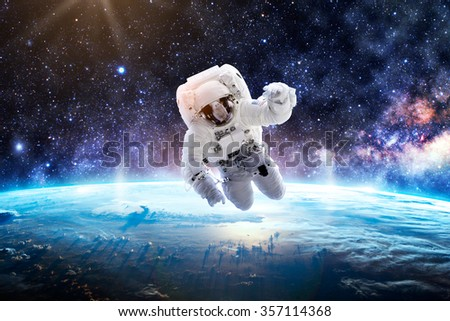 Astronaut Over Earth - Elements of this Image Furnished by NASA #357114368