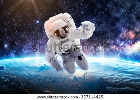 Astronaut Over Earth - Elements of this Image Furnished by NASA #357114425