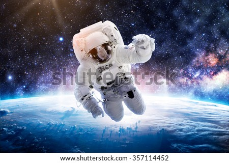 Astronaut Over Earth - Elements of this Image Furnished by NASA #357114452
