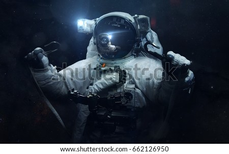 Astronaut. Science fiction space wallpaper, incredibly beautiful planets, galaxies, dark and cold beauty of endless universe. Elements of this image furnished by NASA #662126950