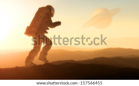Astronaut silhouette against the background of the planet.
