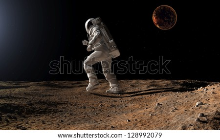 "Astronaut silhouette against the background of the planet.""Elements of this image furnished by NASA"""