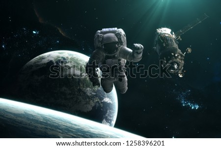 Astronaut, space station, planets and star clusters. Deep space landscape in turquoise light. Science fiction art. Image in 5K for desktop wallpaper. Elements of the image were furnished by NASA