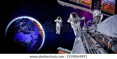Astronaut spaceman do spacewalk while working for space station in outer space . Astronaut wear full spacesuit for space operation . Elements of this image furnished by NASA space astronaut photos.