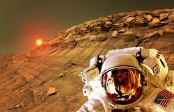 Astronaut spaceman helmet planet Mars surface martian colony space landscape. Elements of this image furnished by NASA.