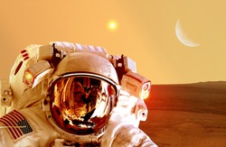 Astronaut spaceman helmet space planet Mars apocalypse moon. Elements of this image furnished by NASA.