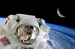Astronaut spaceman isolated helmet space stunning earth moon. Elements of this image furnished by NASA.