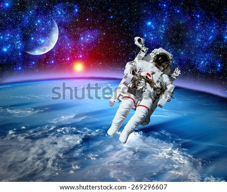 Astronaut spaceman space suit cosmonaut moon earth sun. Elements of this image furnished by NASA. #269296607