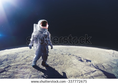 Astronaut standing on the moon #337772675