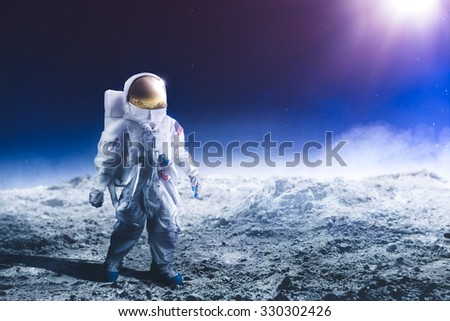 "Astronaut standing on the moon ""Elements of this image were NOT furnished by NASA"" #330302426"