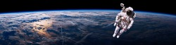 Astronaut walking in space with earth background, panorama. Elements of this image furnished by NASA.